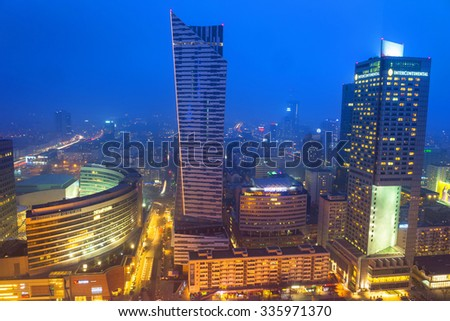 WARSAW, POLAND - 28 FEBRUARY 2014: Aerial view of the city center in Warsaw at night, Poland. Warsaw is the capital and largest city of Poland with population estimated at 1,8 million residents. - stock photo