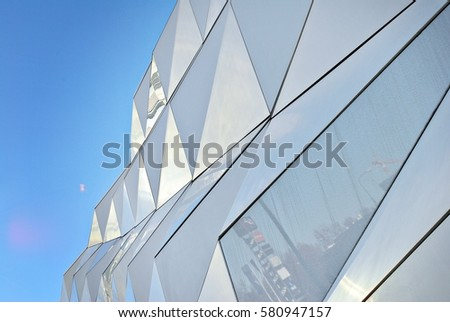 "Warsaw,Poland. 12 February 2017. ""Klif"" Centre is the largest shopping & entertainment centre. Polygonal triangle white facade of modern building"