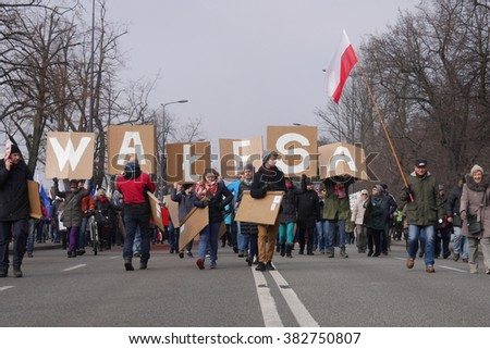 WARSAW, POLAND - FEBRUARY 27, 2016: Poles march against the governmet alleged of breaking democracy standards and in support of Solidarity movement icon Lech Walesa during 'We, the People' march.