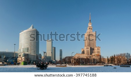 WARSAW, POLAND - JANUARY 23, 2016: Panorama of Warsaw city center, Palace of Culture and Science (PKiN), a landmark and symbol of Stalinism and communism, and modern skyscrapers in winter at sunset