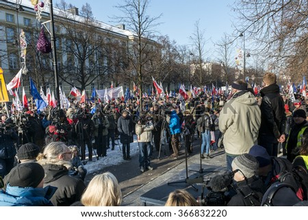 "WARSAW, POLAND - JANUARY 23, 2015: Supporters of democracy during a march organized by the Committee for the Defence of Democracy (KOD) entitled ""In defense of your freedom."""