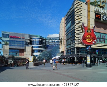 WARSAW, POLAND, 20,JULY 2016 ; Development of city infrastructure in Poland. Modern view of Warsaw with international brands, Hard Rock Cafe and Shopping Mall Zlote Tarasy