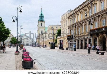 WARSAW, POLAND - JULY 8, 2017: Krakowskie Przedmiescie street, in background Staszic Palace and Basilica of the Holy Cross