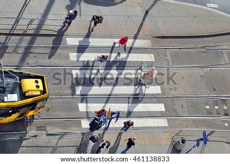 WARSAW, POLAND - JULY 20 - Pedestrians crossing a tramway track and a busy street in the centre of the Polish capital on July 20, 2016 in Warsaw, Poland