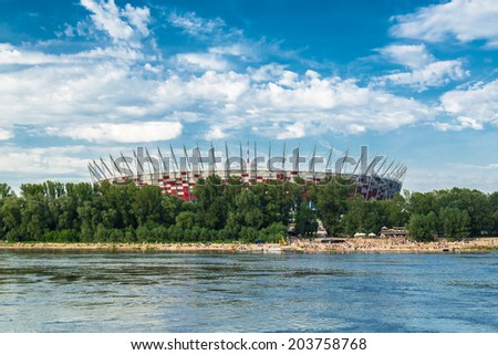 WARSAW, POLAND - JULY 5 ,2014: Polish National Stadium Stadium on July 5 2014. Stadium was build for EURO 2012 Football Championship and hosted the opening match for this event.  - stock photo