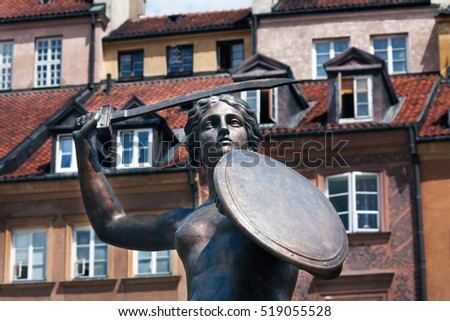 WARSAW, POLAND - July 07, 2010: Statue of Syrenka, Mermaid of Warsaw, symbol of the city of Warsaw, at the Old Town Market Square, Poland