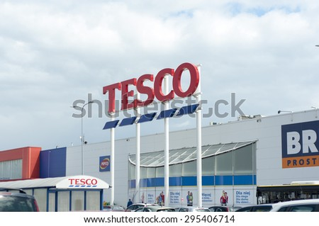 WARSAW, POLAND - JULY 10 2015: Tesco supermarket sign with logo. Potential new government intends to introduce a tax on supermarkets. - stock photo