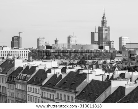 WARSAW, POLAND - JULY 14, 2015: Warsaw city center seen from the Old Town. Modern architecture and the Palace of Science and Culture in the background, traditional houses in the front.
