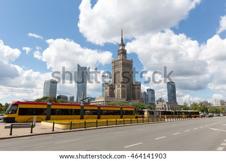 WARSAW, POLAND - JUNE 11, 2016: Architecture in downtown is seen together with the tram and buses standing at the stop one of the main streets of the city