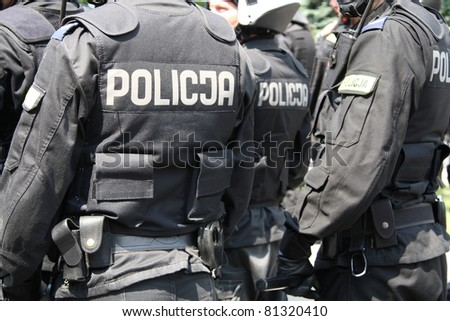 WARSAW, POLAND - JUNE 30:  Closeup of a police cordon protecting government buildings during anti government Solidarity demonstration on June 30, 2011 in Warsaw, Poland.