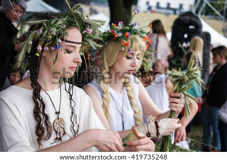 Warsaw, Poland - 20 June 2015: girls with herbal wreaths on midsummer holiday - stock photo