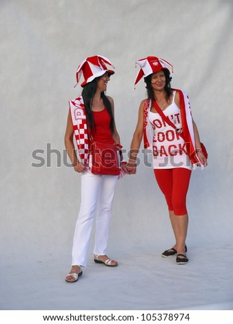 WARSAW, POLAND - JUNE 16: 2 Polish national football fans posing for the national photo before it gets packed for UEFA EURO 2012 football match vs. Czech team, June 16, 2012 in Warsaw, Poland - stock photo