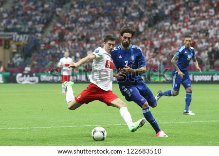 WARSAW,POLAND- JUNE 8,2012:Robert Lewandowski and Giorgos Samaras during the game between Greece and Poland for Euro 2012 in Warsaw on June 8,2012 - stock photo