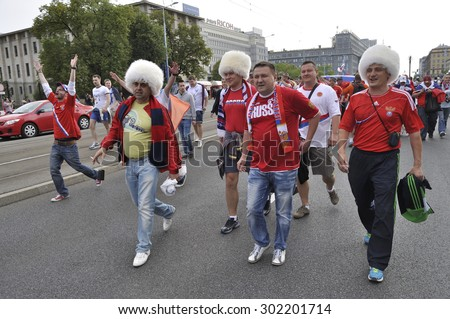 WARSAW, POLAND - JUNE 12, 2012 - Russia fans at the Warsaw street during the Euro 2012 soccer championship Group A match between Poland and Russia. - stock photo
