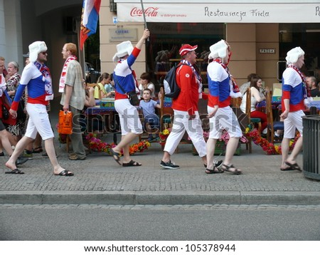 WARSAW, POLAND - JUNE 16: Russian national football team fans going through Nowy Swiat to the National Stadium to see UEFA EURO 2012 football match vs. Greek team, June 16, 2012 in Warsaw, Poland