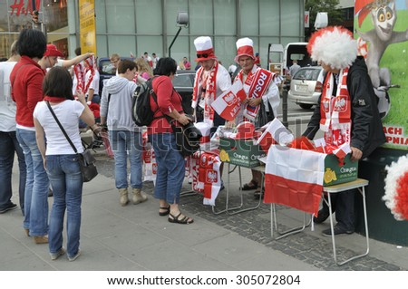WARSAW, POLAND - JUNE 12, 2012 - Street sales of patriotic items for football fans during the UEFA Euro 2012 soccer championships. - stock photo