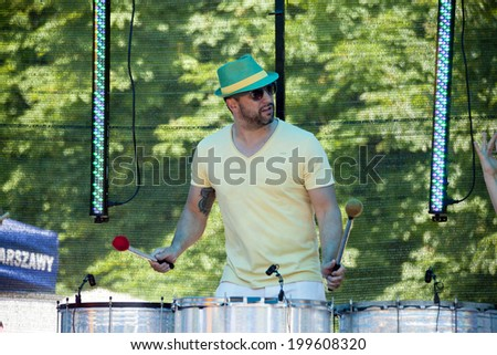WARSAW, POLAND, June 8: Unidentified Carnival musician on the stage on XII Brazilian Festival on June 8, 2014 in Warsaw, Poland. - stock photo