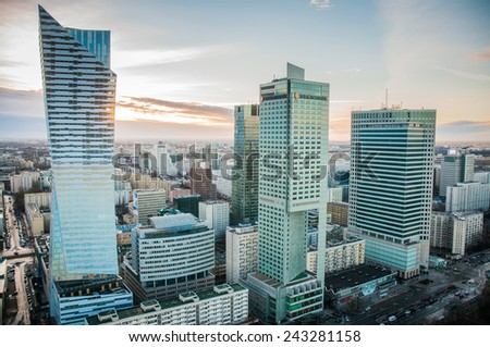 WARSAW, POLAND - MARCH 16: Aerial view with (from left) Zlota 44 building Intercontinental Hotel and Warsaw Financial Centre on March 16, 2014 in Warsaw city centre - stock photo
