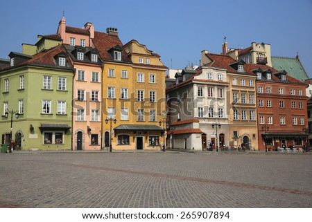 WARSAW, POLAND - MARCH 25, 2015: Castle Square with its colorful Buildings at the Old Town of Warsaw. - stock photo