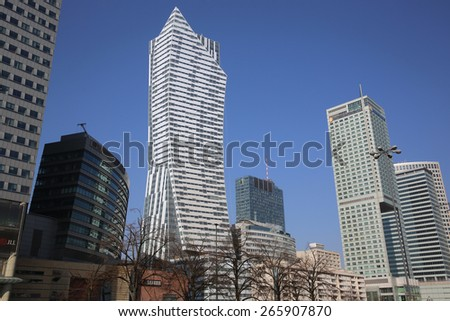 WARSAW, POLAND - MARCH 24, 2015: Skyscraper at Business District in Warsaw. Its the new Center of Warsaw beside the Culture Palace, with Restaurants, Shopping Mall and Office Buildings. - stock photo