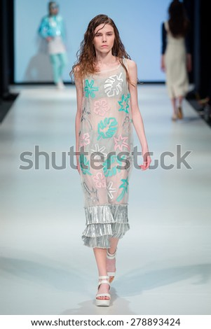 WARSAW, POLAND - MAY 17, 2015: A model walks the catwalk in designs from the new collection by Natalia Rivera Studio at Mercedes-Benz Fashion Weekend Warsaw on May 17, 2015 in Warsaw, Poland. - stock photo