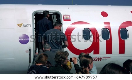 WARSAW, POLAND - MAY, 18, 2017. Air Berlin plane boarding at the airport