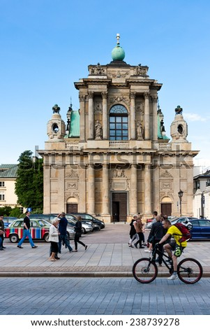 WARSAW, POLAND - MAY 18, 2010: Carmelite Church in Warsaw, 17th century neoclassical style and citizens of Warsaw City - stock photo