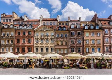 WARSAW, POLAND - MAY 28, 2016: Colorful buildings on Old Town Market Place (Rynek Starego Miasta) in Warsaw, Poland. UNESCO World Heritage Site. - stock photo