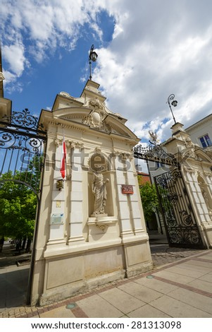 WARSAW, POLAND - MAY 03, 2015: Detail of The historic Gate to the University of Warsaw, designed by Stefan Szyller in Neo-Baroque style around 1900 was put into use in 1911  - stock photo