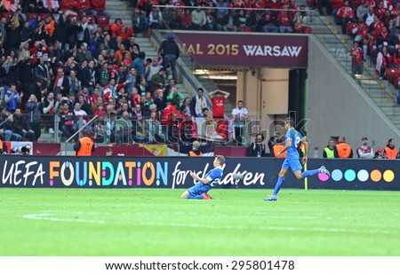 WARSAW, POLAND - MAY 27, 2015: FC Dnipro players (Ruslan Rotan and Leo Matos) celebrate after Rotan scored a goal during the UEFA Europa League Final game against FC Sevilla - stock photo