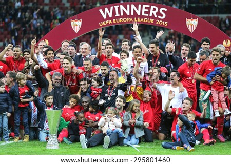WARSAW, POLAND - MAY 27, 2015: FC Sevilla club - the Winner of the UEFA Europa League 2015 poses for a group photo with the Trophy at Warsaw National Stadium - stock photo