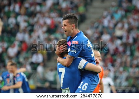 WARSAW, POLAND - MAY 09, 2015: Happy Lech Poznan players after scoring a goal during Polish League football match between Legia Warsaw and Lech Poznan in Warsaw. - stock photo