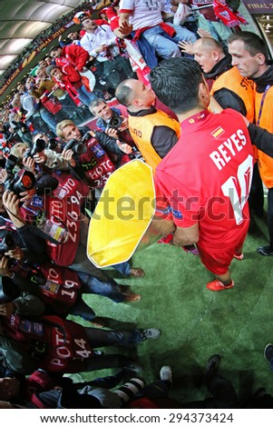 WARSAW, POLAND - MAY 27, 2015: Jose Antonio Reyes of FC Sevilla (C) poses for a photo with UEFA Europa League Cup (Trophy) after the game against FC Dnipro at Warsaw National Stadium - stock photo