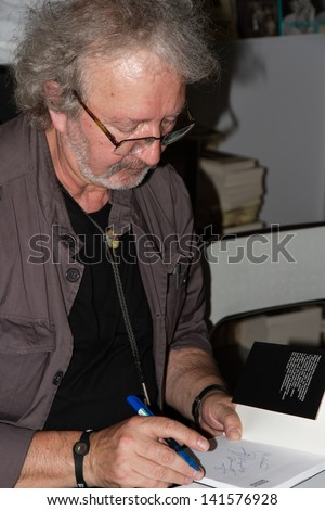 WARSAW, POLAND - MAY 18: Krzysztof Daukszewicz signs his book on the Fourth Book Fair held at the National Stadium on May 18, 2013 in Warsaw