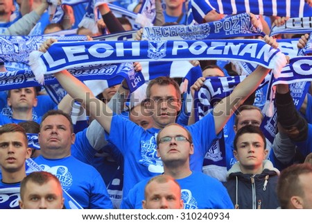 WARSAW, POLAND - MAY 02, 2015: Lech Poznan fans during Polish Cup Final football match between Legia Warsaw and Lech Poznan at the National Stadium in Warsaw. - stock photo
