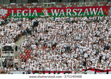 WARSAW, POLAND - MAY 02, 2015: Legia Warsaw fanatic fans during Polish Cup final football match between Legia Warsaw and Lech Poznan in Warsaw. - stock photo