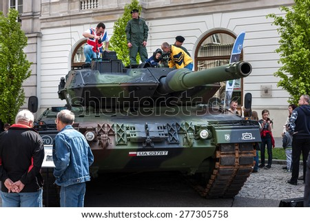 WARSAW, POLAND - MAY 08, 2015: Leopard 2 tank, improved 2A5 version. People curiously looking and learning during the public celebrations of 70th Anniversary of End of WW II - stock photo