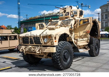 WARSAW, POLAND - MAY 08, 2015: Oshkosh M-ATV, mine resistant ambush protected all-terrain vehicle. Public celebrations of 70th Anniversary of End of World War IIar II - stock photo