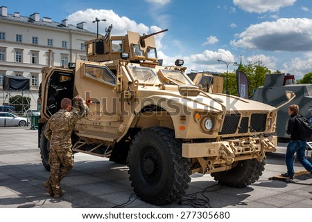 WARSAW, POLAND - MAY 08, 2015: Oshkosh M-ATV with a manned turret machine gun, mine-resistant vehicle. Public celebrations of 70th Anniversary of End of World War II - stock photo