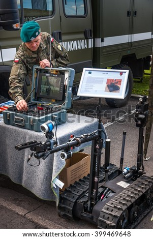 WARSAW, POLAND - MAY 08, 2015:  Sapper at the control board of tracked Robot TALON. 70th anniversary of End of WW II - stock photo
