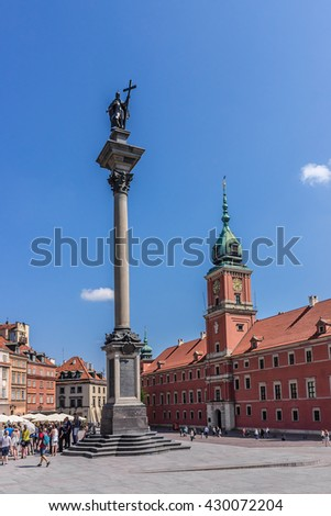 WARSAW, POLAND - MAY 28, 2016: Tourists on Castle Square near Royal castle. Royal Castle - iconic appearance and one of Warsaw's most recognizable landmarks. Old town - UNESCO World Heritage Site. - stock photo