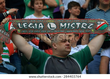 WARSAW, POLAND - MAY 09, 2015: Unidentified fan of Legia Warsaw during Polish League football match between Legia Warsaw and Lech Poznan in Warsaw.