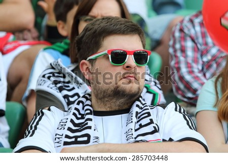 WARSAW, POLAND - MAY 31, 2015: Unidentified fan of Legia Warsaw during Polish League football match between Legia Warsaw and Wisla Krakow at the Pepsi Arena in Warsaw. - stock photo