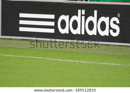 WARSAW, POLAND - November 28: Adidas banner on the stadium during UEFA Europa League football match between Legia Warsaw and Lazio Rome, on November 28, 2013 in Warsaw, Poland.  - stock photo