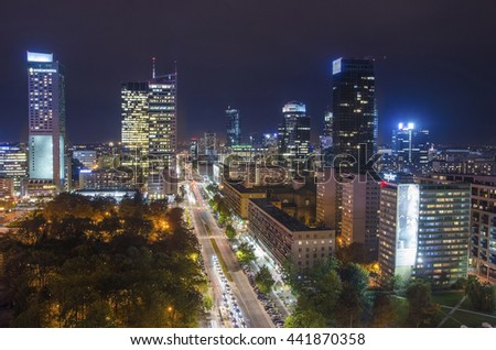 WARSAW, POLAND - 28 NOVEMBER 2015: Aerial view of the city center in Warsaw at night, Poland. Warsaw is the capital and largest city of Poland with population estimated at 1,8 million residents.