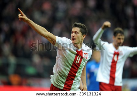 WARSAW, POLAND - NOVEMBER 13, 2015: EURO 2016 European Championship friendly game Poland - Iceland o/p Robert Lewandowski goal bayern munich - stock photo