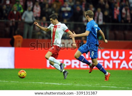WARSAW, POLAND - NOVEMBER 13, 2015: EURO 2016 European Championship friendly game Poland - Iceland o/p Robert Lewandowski Holmar Orn Eyjolfsson goal