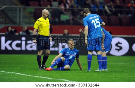 WARSAW, POLAND - NOVEMBER 13, 2015: EURO 2016 European Championship friendly game Poland - Iceland o/p refree Padraigh Sutton Kolbeinn Sigthoresson penalty - stock photo