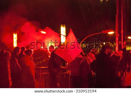 WARSAW, POLAND - NOVEMBER 11: Protests and riots at night during polish Independence day in Warsaw in November 11, 2014 - stock photo