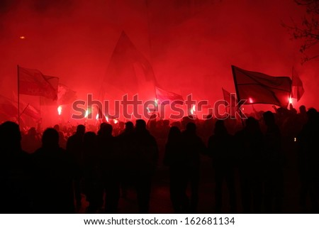 WARSAW, POLAND - NOVEMBER 11: The riots in the streets of Warsaw during the celebration of Independence Day on November 11, 2013 in Warsaw, Poland.  - stock photo